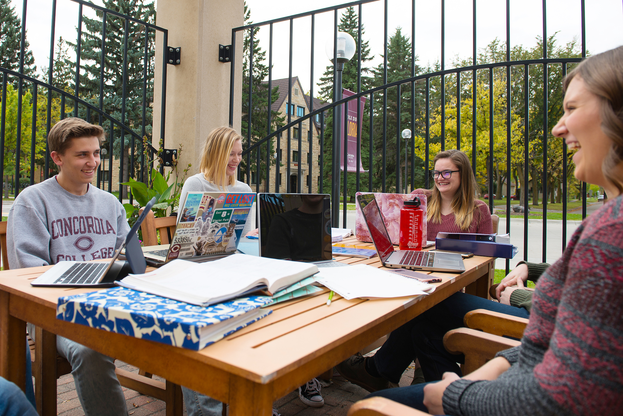 students at Anderson Commons patio table