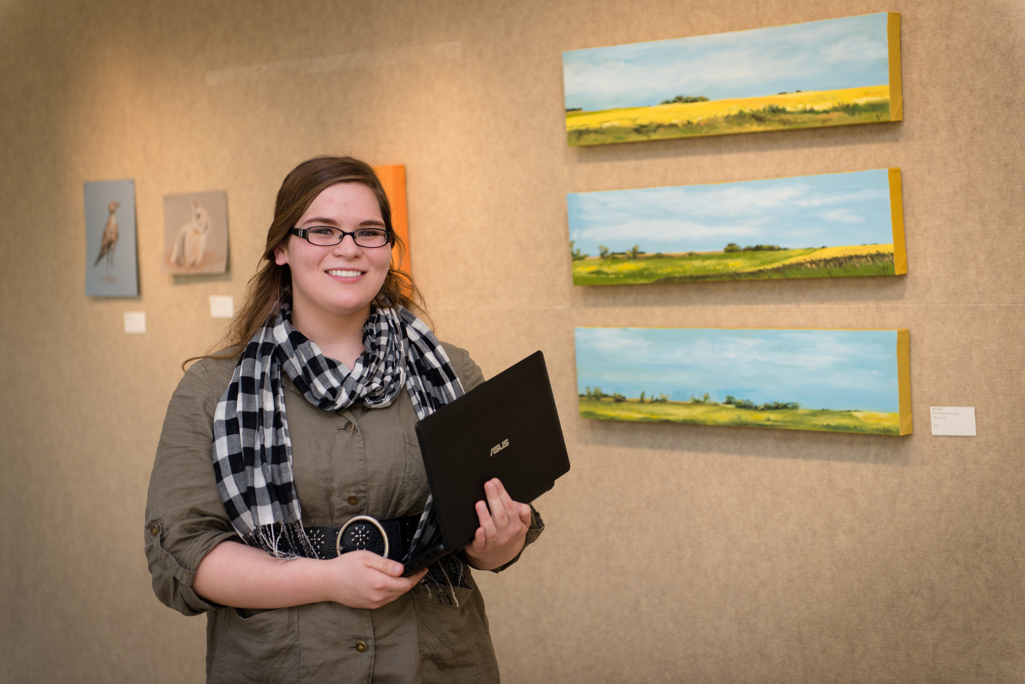 Aliza Rux '17 employs interdisciplinary skills as curator for the Invitational Alumni Art Exhibit in Concordia's Cyrus M. Running Gallery this fall.