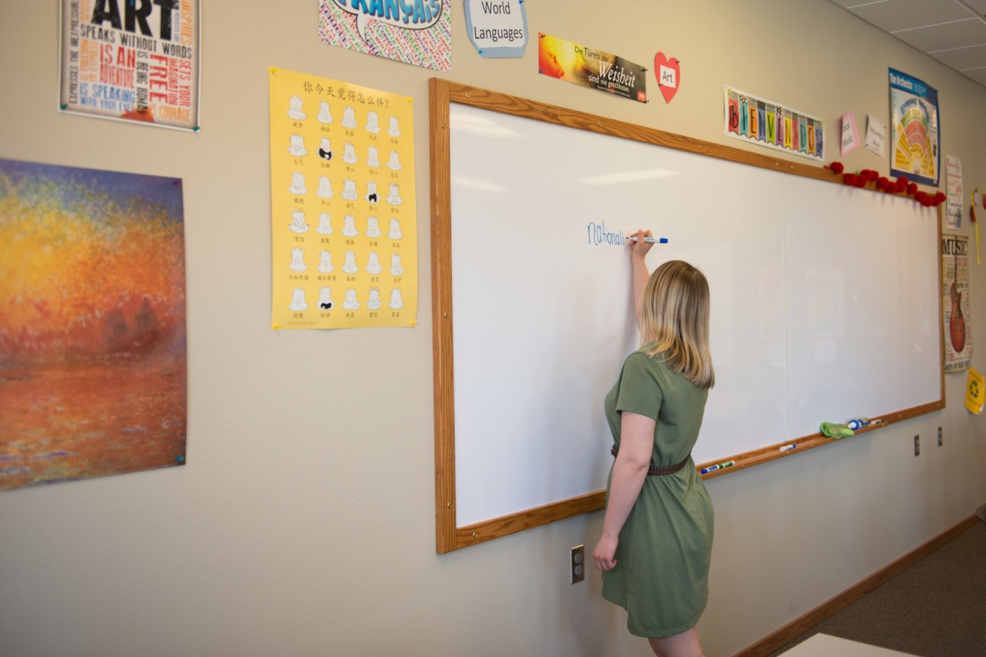 Allison Ross writing on whiteboard in classroom