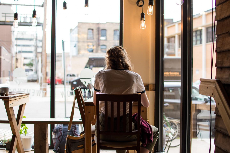 Ali Froslie sitting in coffee shop