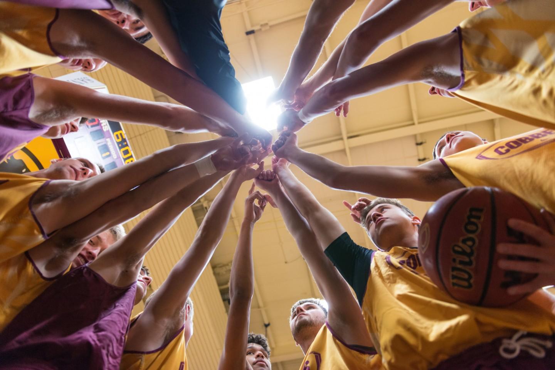 basketball team hands together