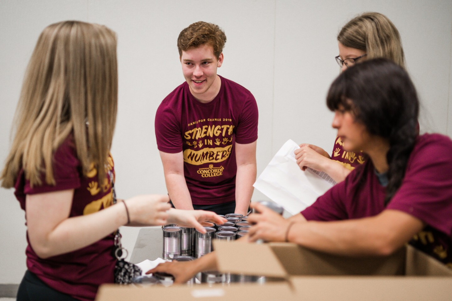 Cobbers packing items at food bank