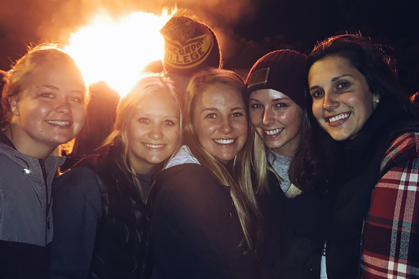 students in front of bonfire at homecoming