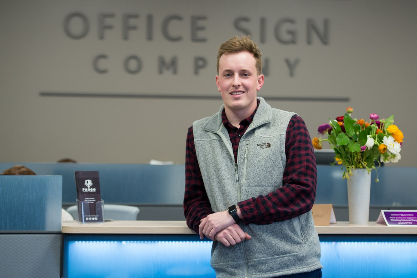 Jack Yakowicz in front of Office Sign Company sign