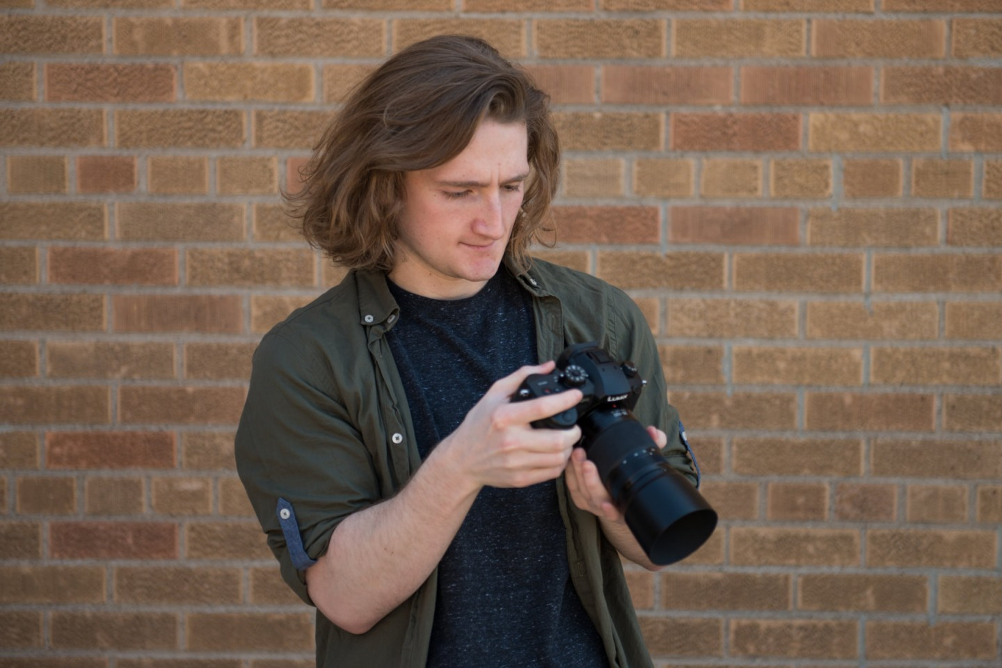 Josh Quatier looking at image on back of camera
