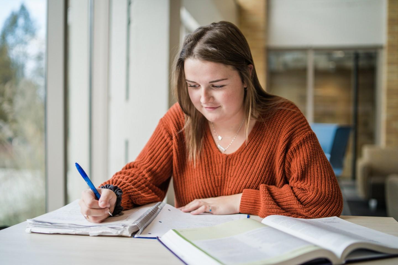 Katelin Krueger studying by window