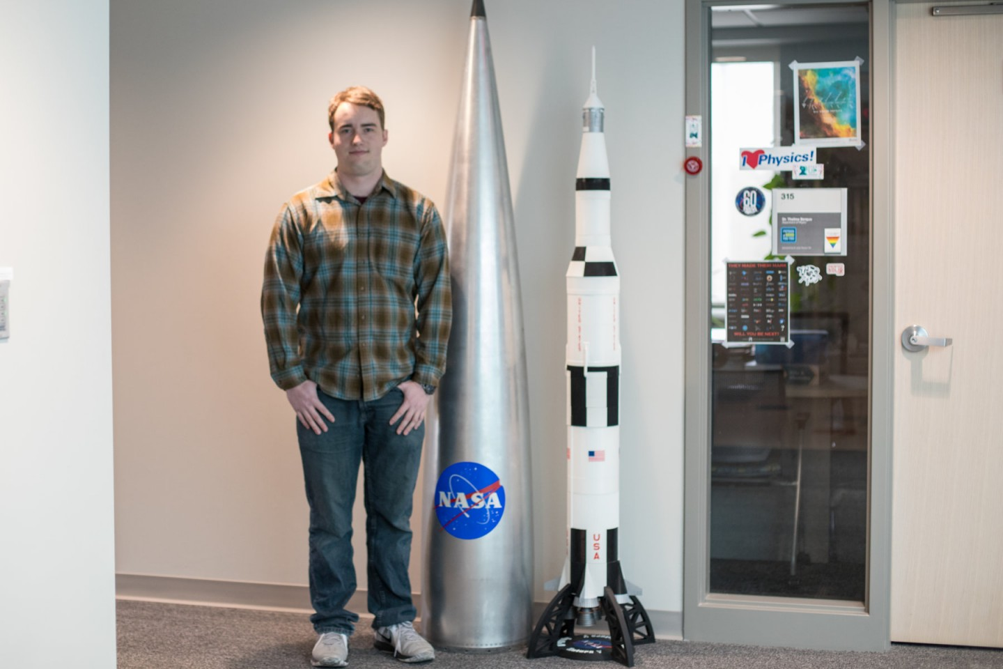 Tommy Styrvoky standing next to 3D printed rocket