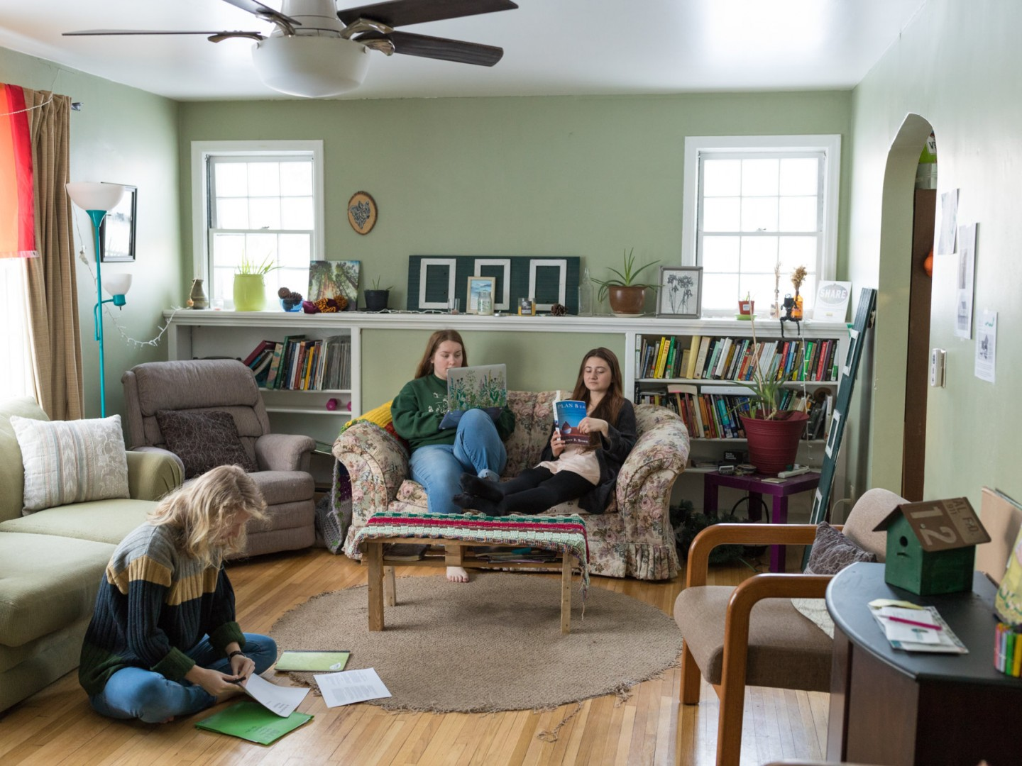 Eco House residents studying in livingroom