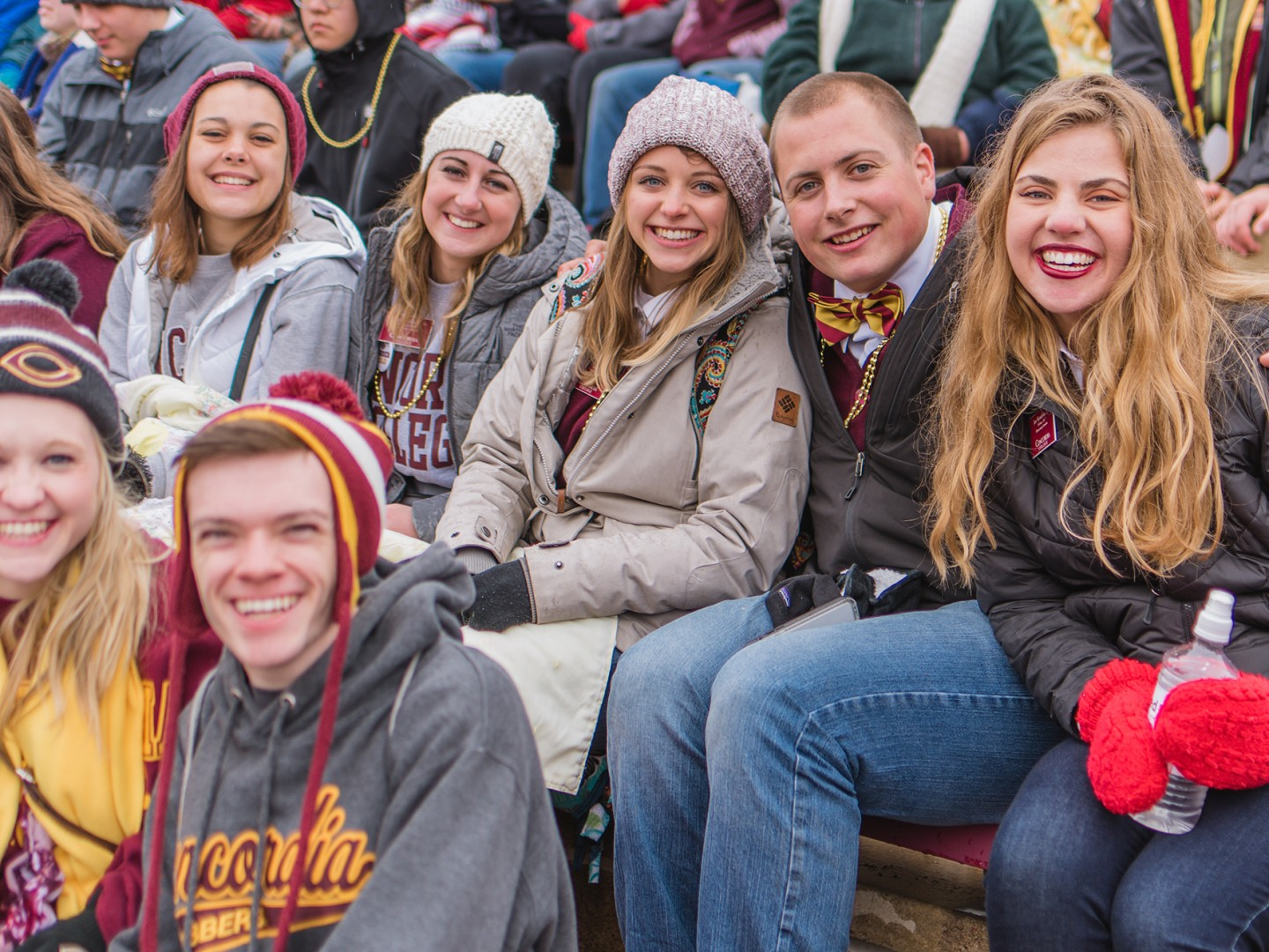 Tate Hovland and students in stands at football game