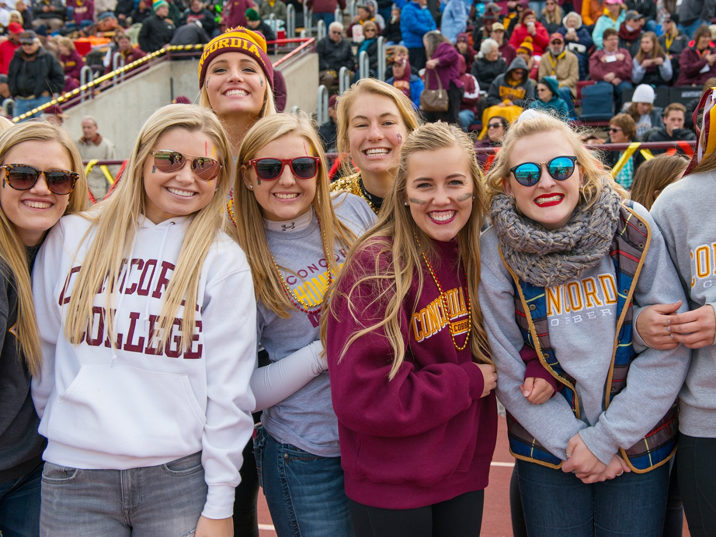 Cobbers in front of stands at Football game