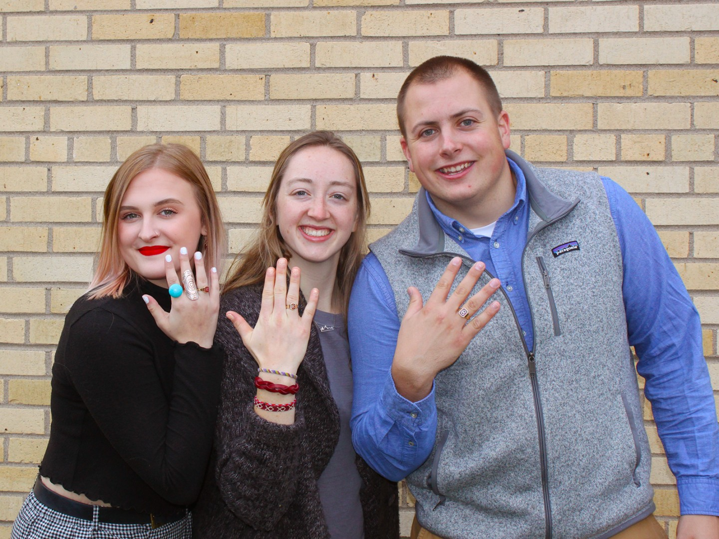 3 Concordia students showing Cobber rings