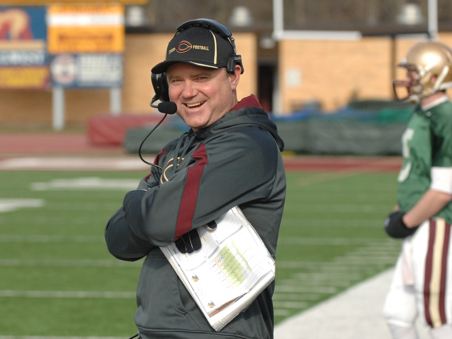 Coach Terry Horan smiles at game