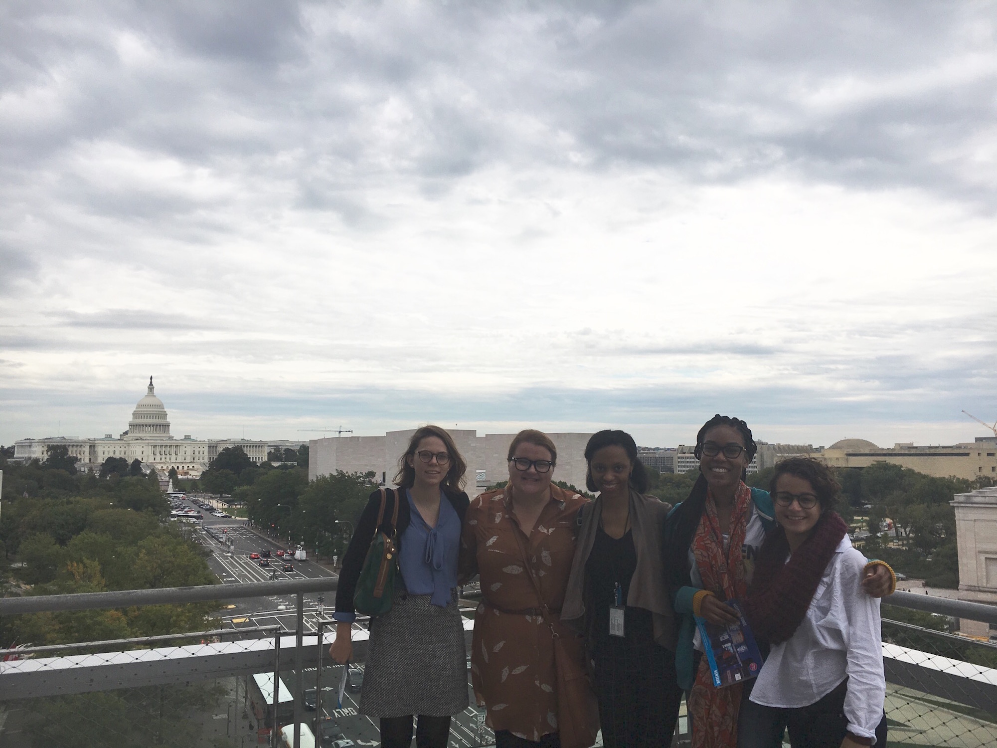 Interns from the National Museum of American History with Pennsylvania Avenue and the Capitol in the background