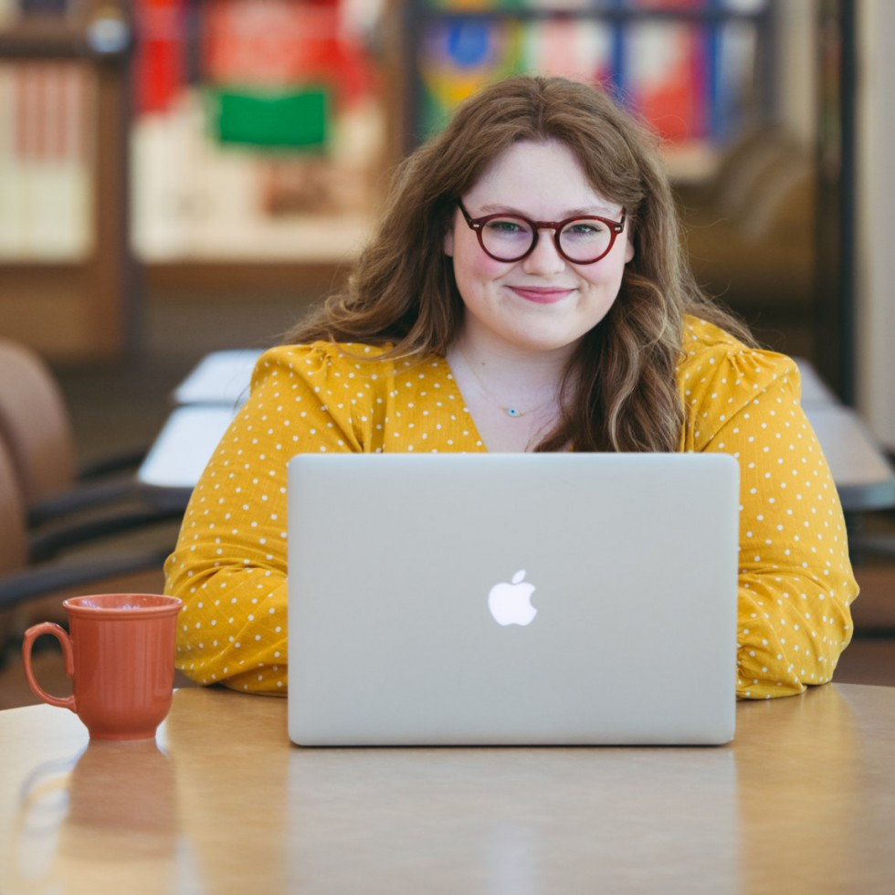 Carly Erickson on laptop