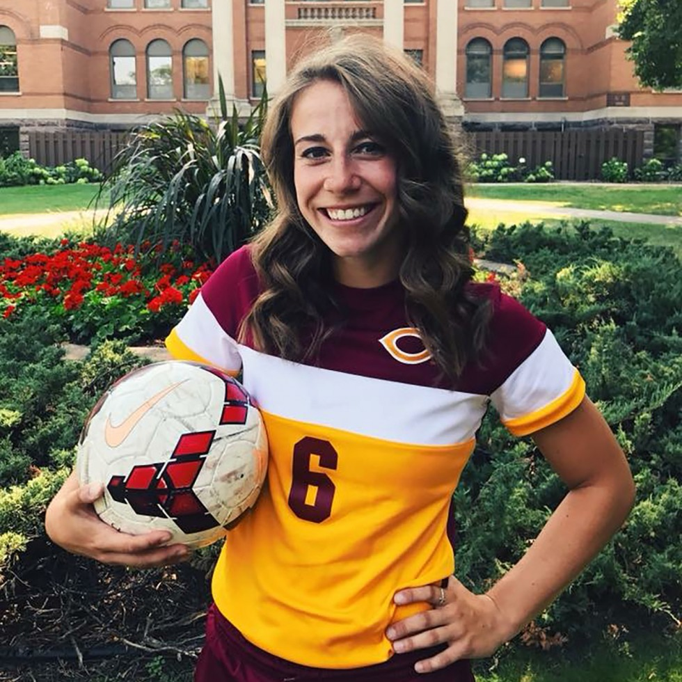 Rachel Osmundson with soccer ball in front of Old Main