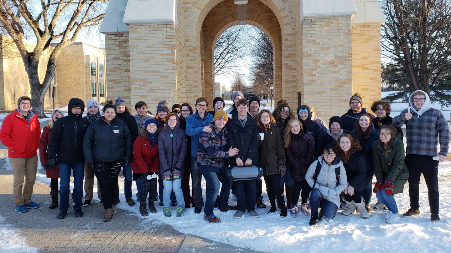 Cobbers in Action Club in front of bell tower